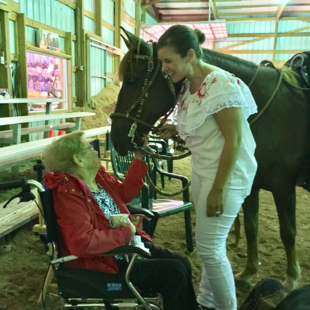 Aura with her Grandma Skarpohl after a Peruvian Horse demostration. Photo by Mary Skarpohl.
